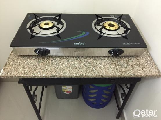 Twin Stove, Woqood Cylinder with regulator and hose for sale.