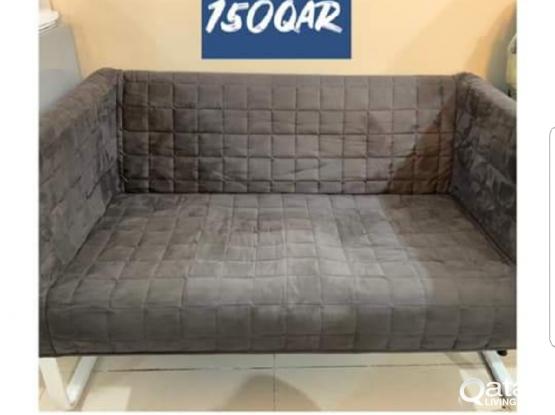 IKEA sofa and computer tablet