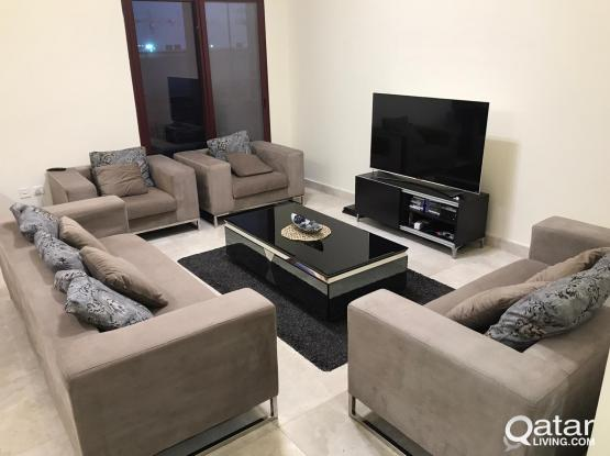 7 seat sofa set with glass coffee table and rug (used)