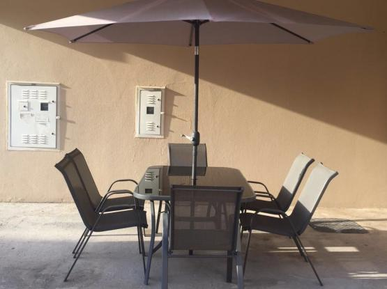 6 Garden Chairs and table with umbrella