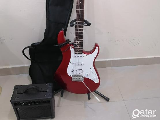 Yamaha Electric guitar EG 112 C with gig bag, , ampli-speaker, cable, strap and stand.