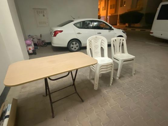 6 Plastic Chairs And Foldable Wooden Table