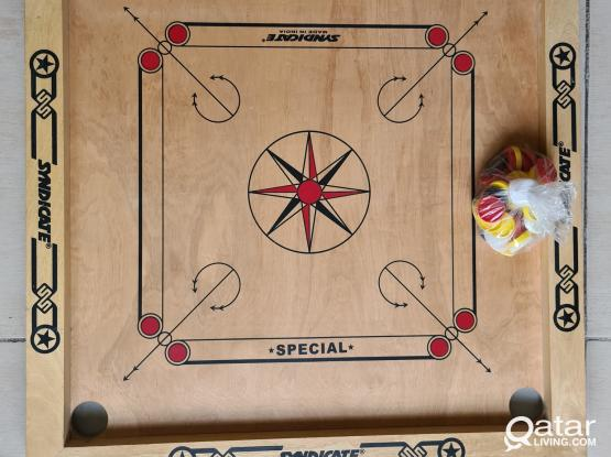 Carom board with coins