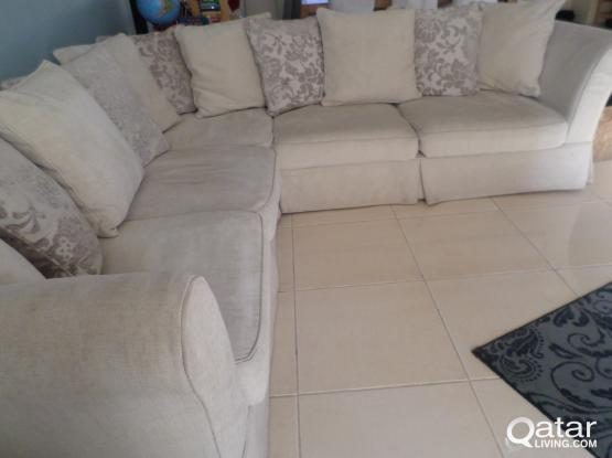 Ivory coloured L shaped settee