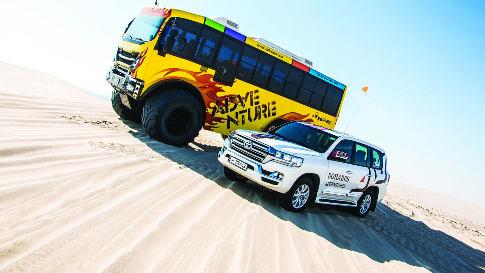 Take a ride through the mighty dunes of Qatar with Doha Bus