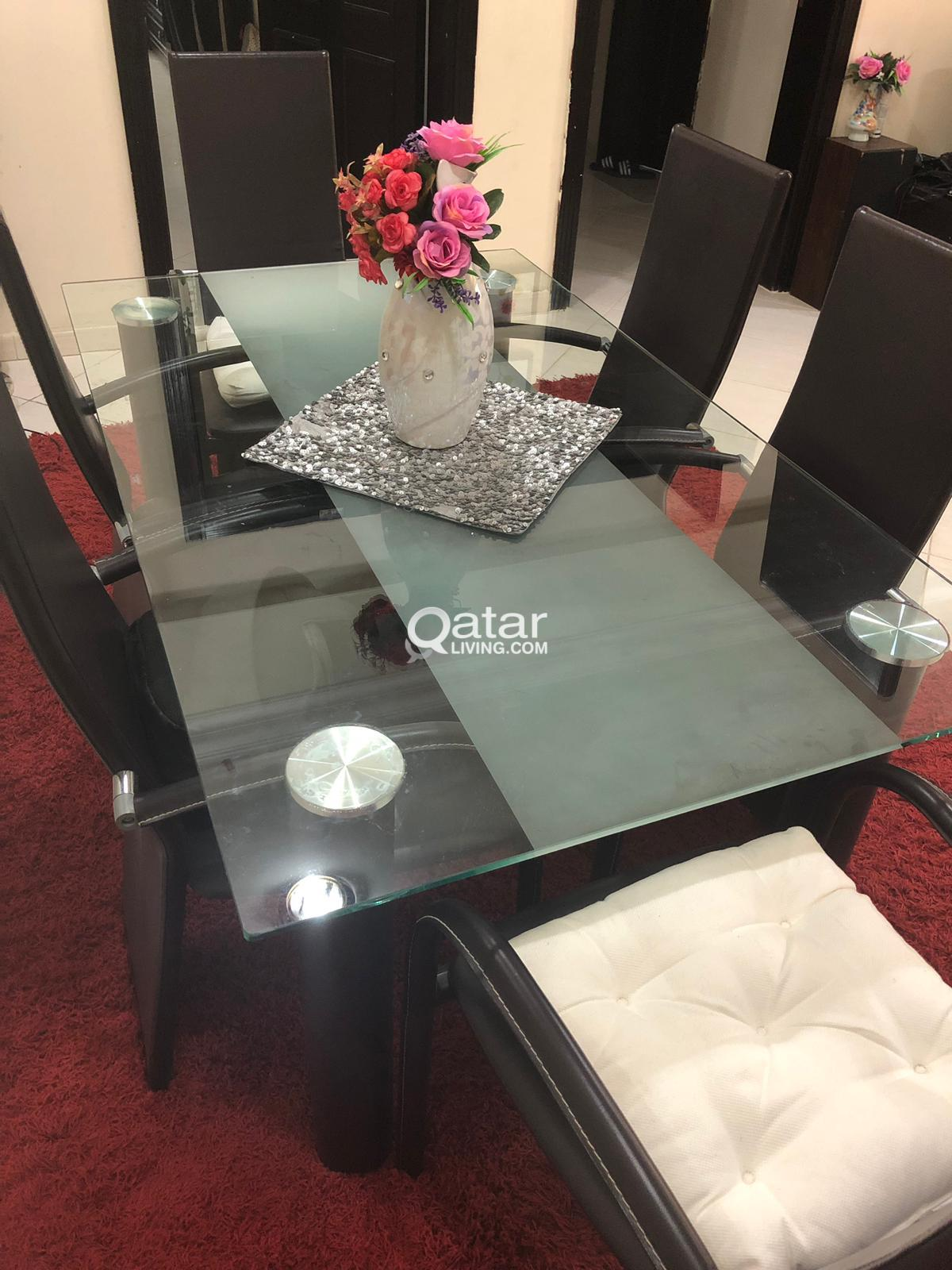 Glass table with 6 leather chairs good same new